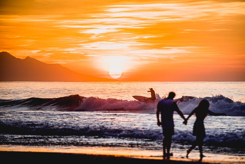 Sunrise surfers in bali