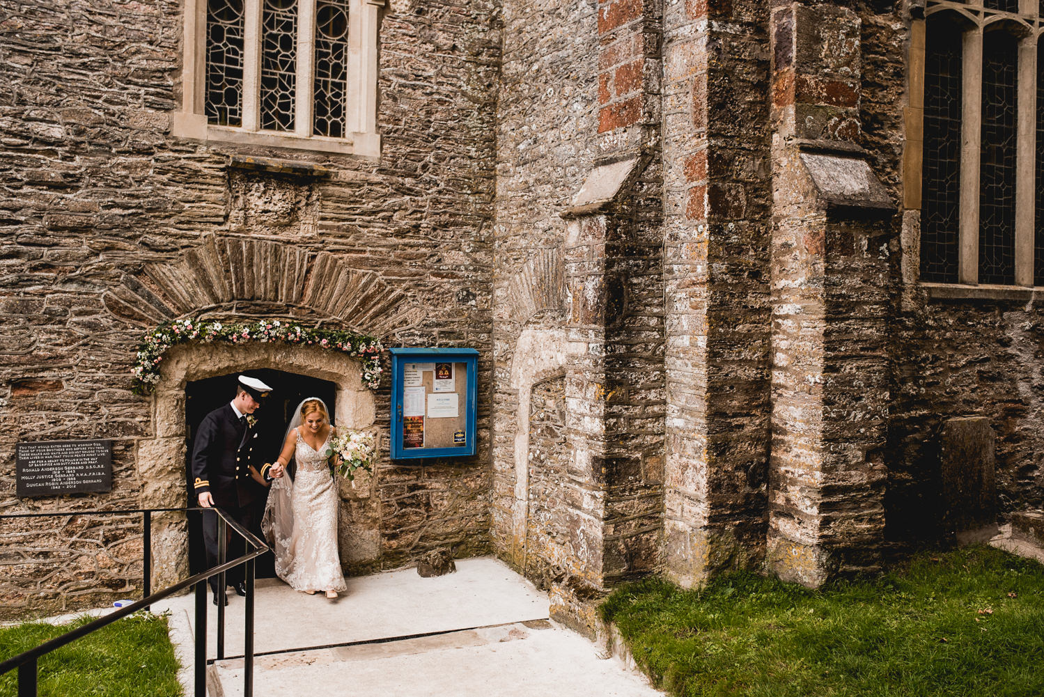 bride and groom exit the dartmouth church