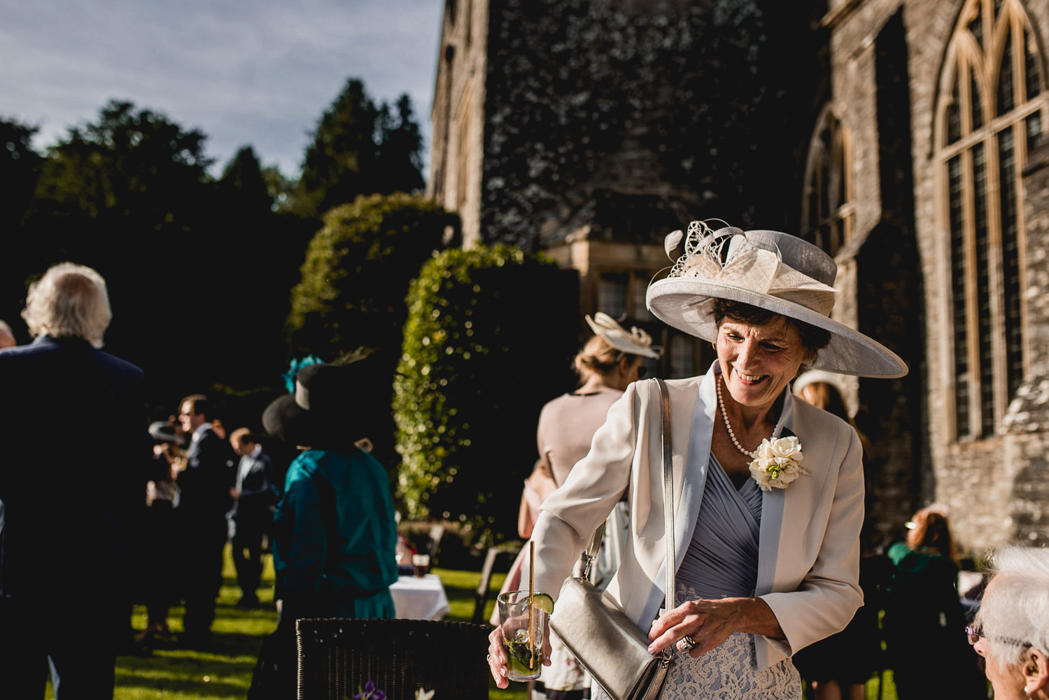 guests in the sunshine at Dartington Hall Wedding Photographer